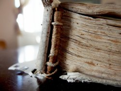 Headband tackets on the original 16th century ledger book